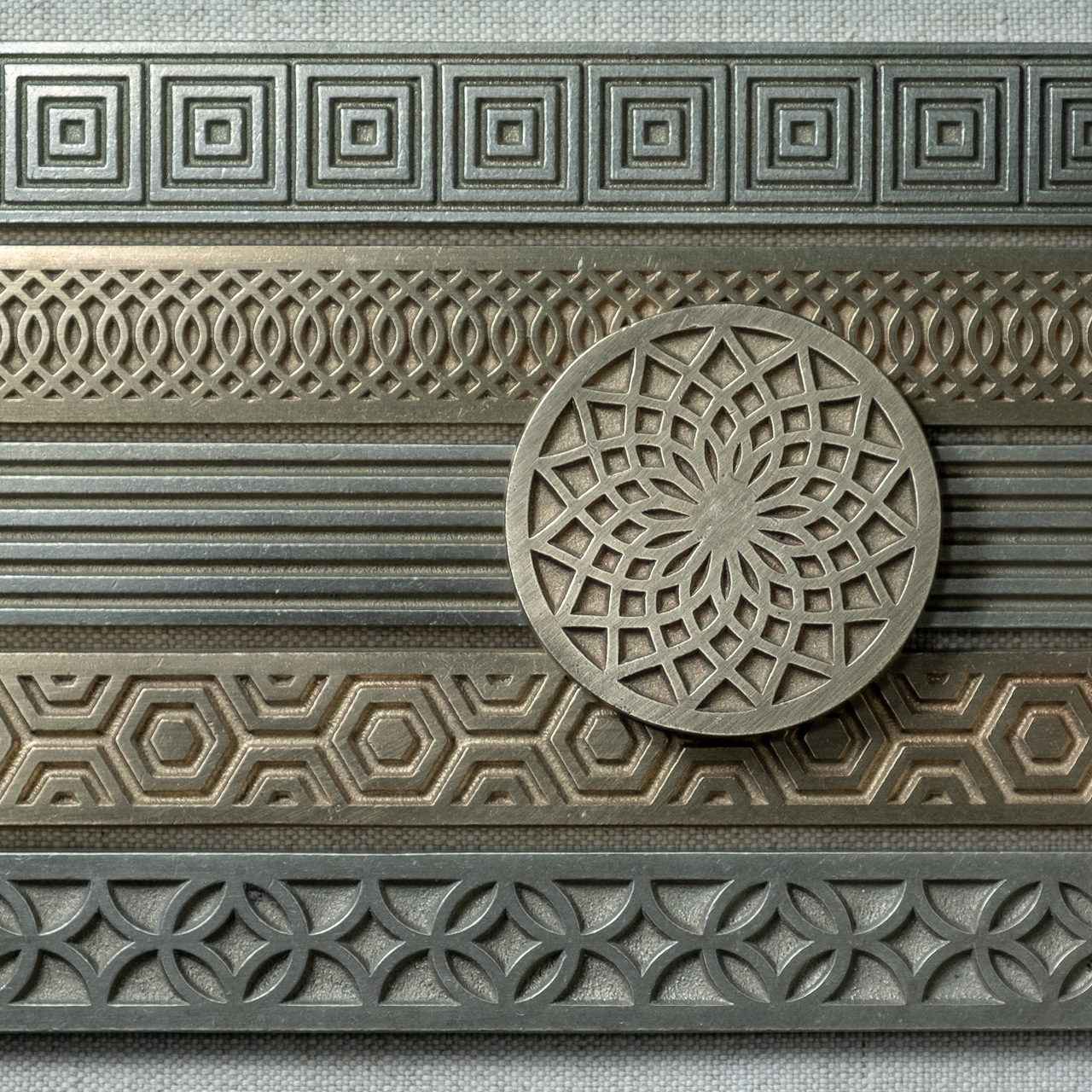 Lowitz & Company | Luxury Designer Tile | Metal Inserts | White Patterned Field Tile