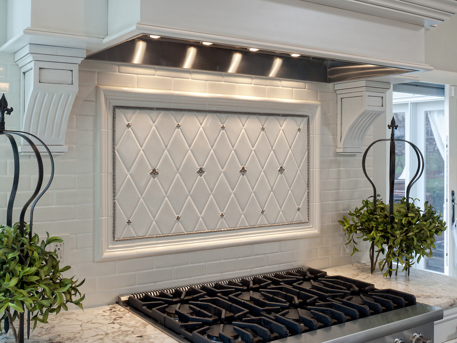 Drury Design kitchen featuring Bronzework Studio metal inset tiles