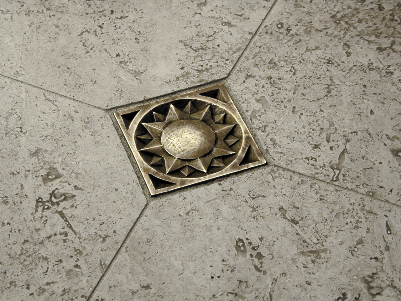 Sun 3x3 in Traditional Bronze with gray travertine limestone