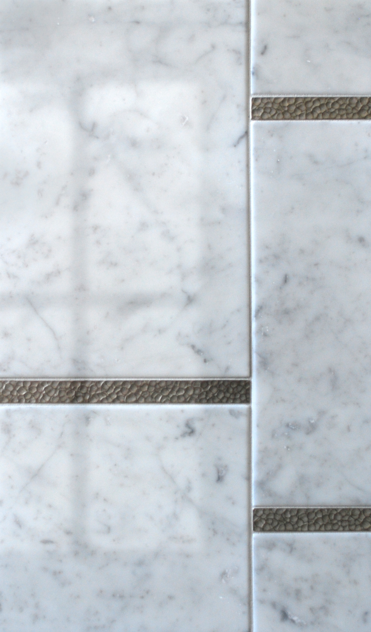 Metal accent liners: Water Song Liner in White Bronze with white marble