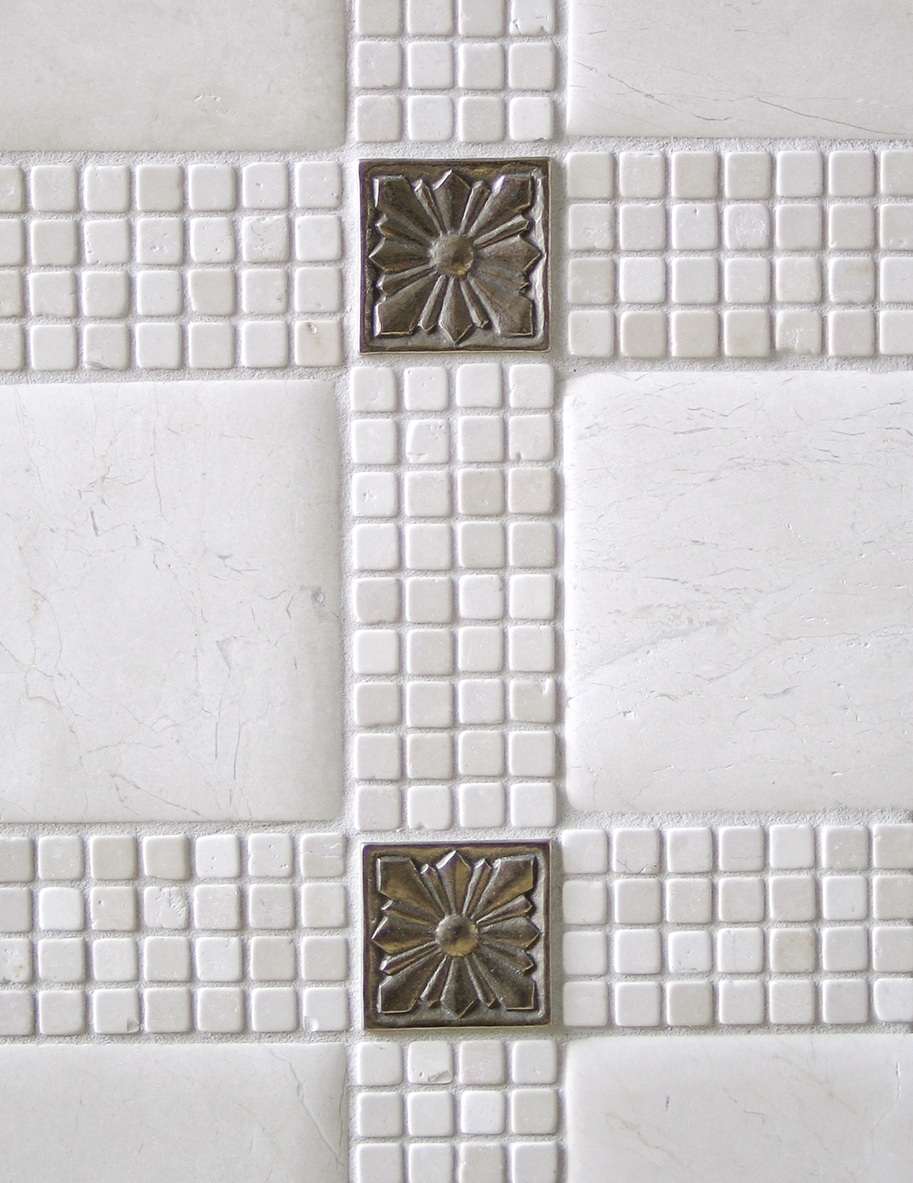 Metal accent tile: Sunrise in White Bronze with limestone mosaic