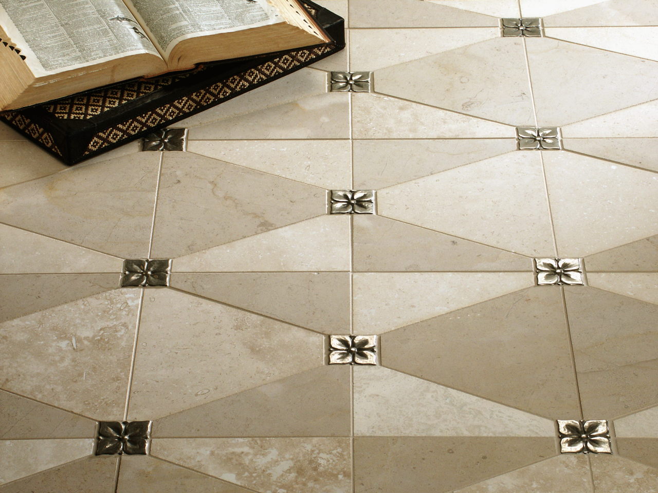 Metal accent tiles: Blooming Leaf in Traditional Bronze with limestone