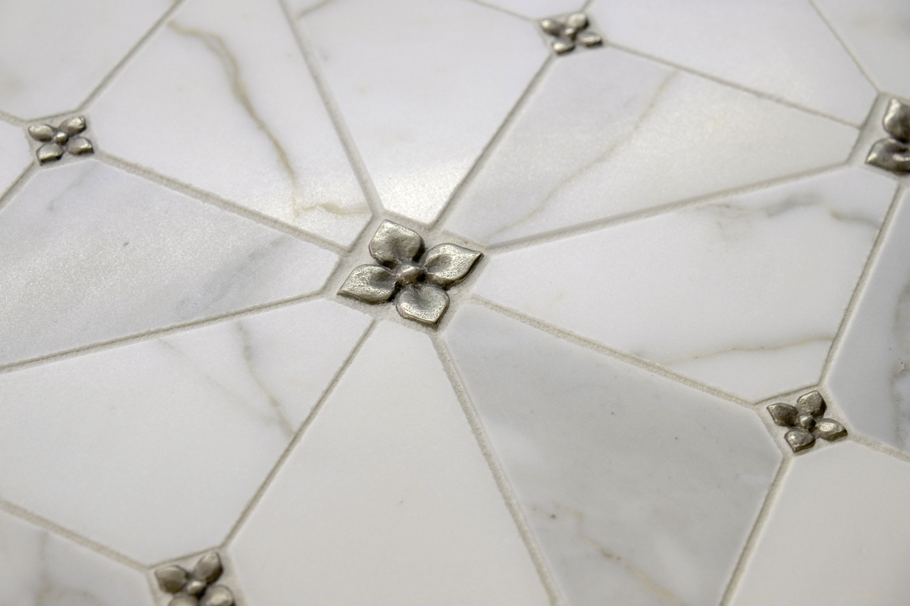Metal accent tiles: Blooming Leaf in White Bronze in two sizes with Calacatta Marble